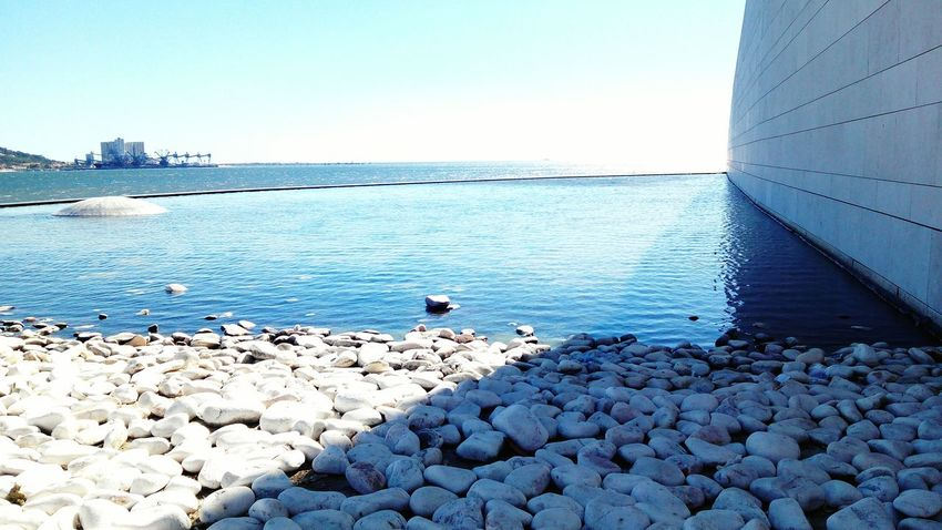 Architecture Water Clear Sky Stone - Object Tranquil Scene Scenics Tranquility Sea Pebble Day Nature Travel Destinations Riverbank Beauty In Nature Concrete Outdoors Non-urban Scene Sky Seascape Vacations Stone Material