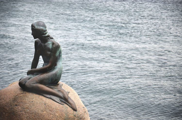 Water Sea Day Nature Copenhagen, Denmark Denmark 🇩🇰 Denmark EyeEmNewHere EyeEmBestPics EyeEm Gallery EyeEm Best Shots The Week On Eyem Copenhagen LittleMermaid One Person Sitting Mermaid Syrena København Neighborhood Map