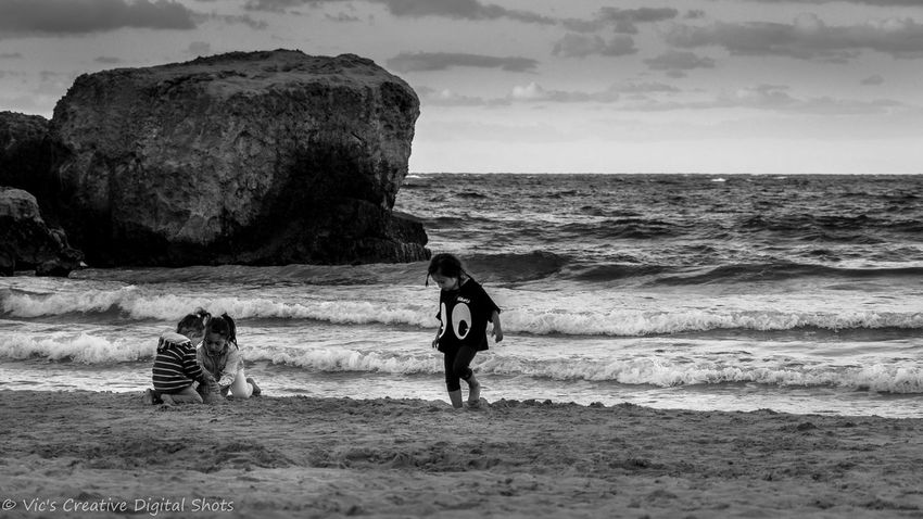 Horizon Over Water Monochrome Photography Real People Sand Beach Shore Blackandwhite People Wave Puglia Salento Italy Youth Growing Children Kids Kids Having Fun Playing Having Fun Free Freedom Young Life In Motion Capture The Moment Capturing Freedom