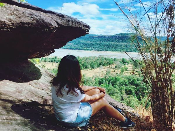 Real People Sitting One Person Tree Leisure Activity Long Hair Nature Casual Clothing Full Length Day Lifestyles Beauty In Nature Young Adult Young Women Relaxation Outdoors Sky Scenics Landscape