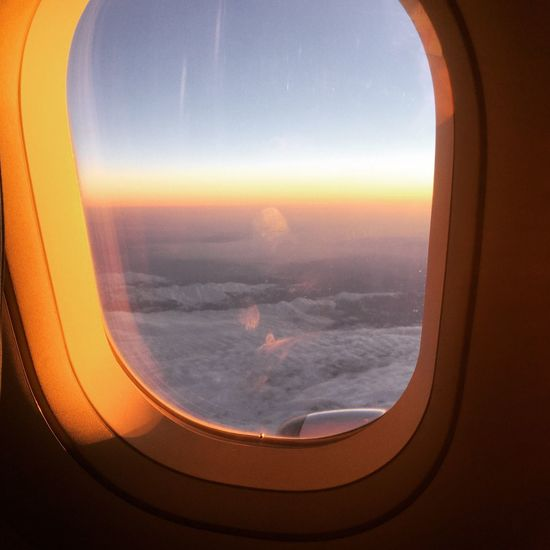 Window Airplane Transportation Travel Journey Air Vehicle Vehicle Interior Sky Mode Of Transport Sunset Flying No People Aerial View Cloud - Sky Scenics Beauty In Nature Mid-air Commercial Airplane Airplane Wing Nature