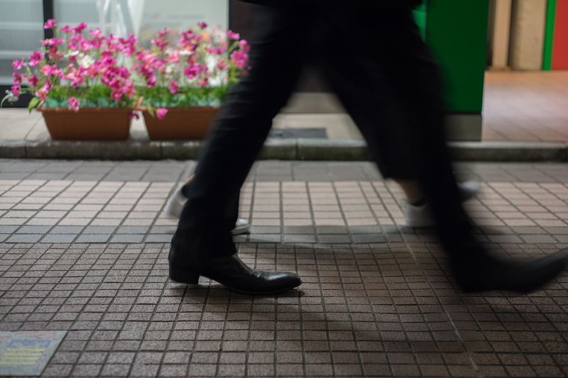 Tokyo Kichijyoji. Snapshots of Life Low Section Flower Flowering Plant Human Body Part Human Leg Body Part One Person Plant Blurred Motion Day Lifestyles Footpath Outdoors Human Limb Shoe Limb Adult Real People Motion Walking