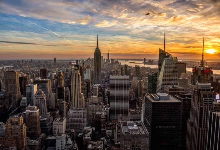 Cold winter sunset on Top of the Rock Clouds And Sky Empire State Building Rockefeller Center Top Of The Rock NYC Helicopter Manhatten New York City Sunset Architecture City Building Exterior Sky Skyline Cloud - Sky Downtown Urban Skyline Outdoors First Eyeem Photo