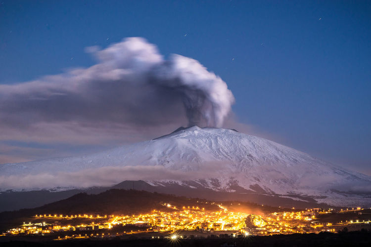Scenic view of smoke emitting from volcanic crater during winter