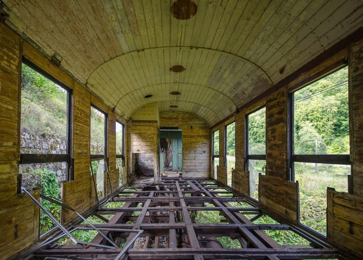 Interior Of Abandoned Train In Forest