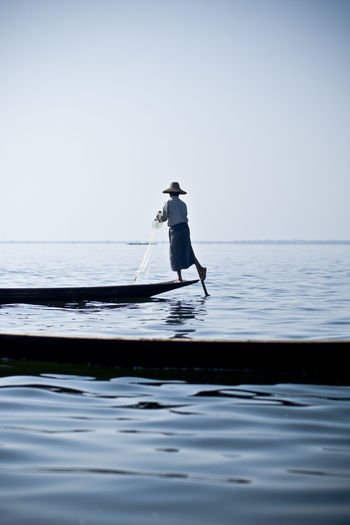 inle lake fisherman Alone Beauty In Nature Burma Calm Check This Out Clear Sky Fisherman Hanging Out Inle Lake Intha Myanmar Nature Ocean People And Places Remote Scenics Sea Solitude TakeoverContrast The Color Of Business Tranquil Scene Tranquility Traveling Water Waterfront