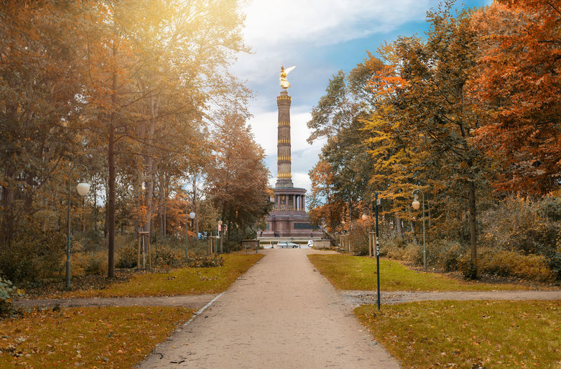 The Victory Column in Berlin, Germany, on a sunny day in October Autumn Berlin October Siegessäule  Tiergarten Tourist Attraction  Travel Tree Architecture Autumn Built Structure Day Fall Germany Leaf Nature Outdoors Park Sky Sun Tourism Travel Destinations Tree Victory Column