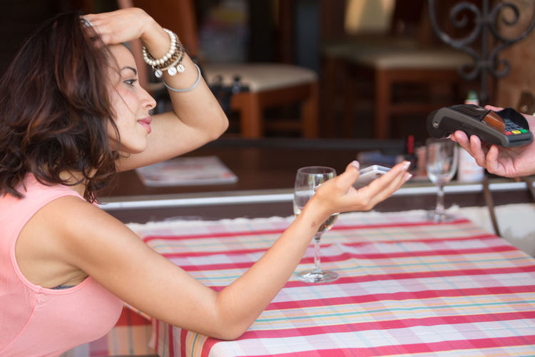 Woman using phone while sitting