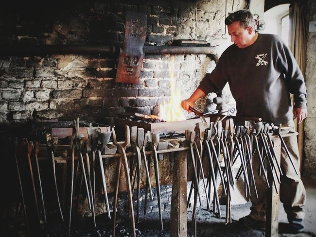 Blacksmith... Only Men One Man Only Adults Only Workshop Business Finance And Industry Skill  Indoors  Metal Industry People Blacksmith  Forge  Brick Wall Brickyard Handmade Man At Work Handcraft Fire Tool Tools Second Acts