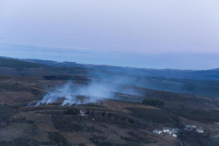 Aerial view of smoke emitting over land