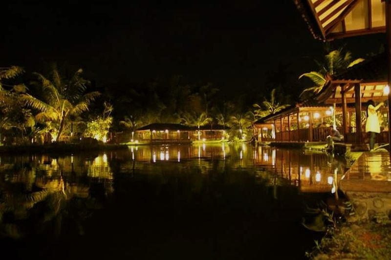 the Westlake resto Jogjakarta Westlakeresto  Tree Water Illuminated Palm Tree Tourist Resort Luxury Travel Palace Waterfront Houseboat Standing Water Water Vehicle Lake Moored King - Royal Person Reflection Wooden Raft Canal Boat Rippled Doges Palace Coconut Palm Tree Royalty Tropical Tree Pavilion Stilt House Calm