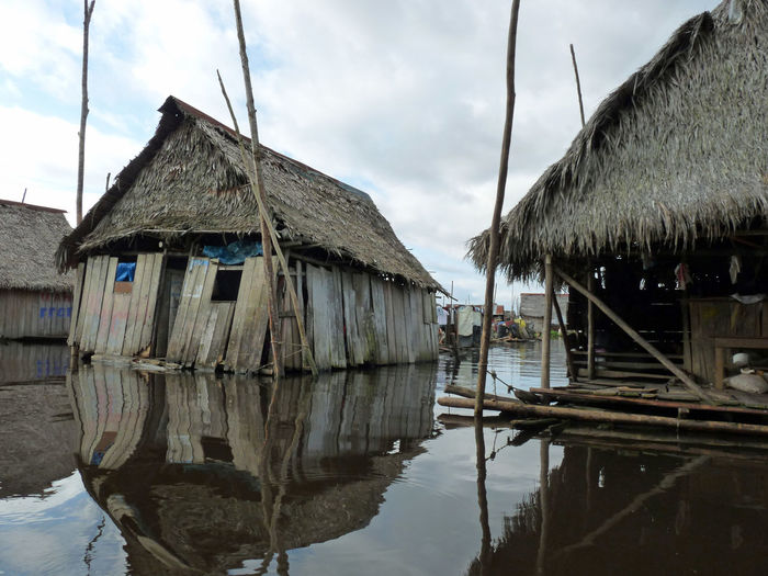 Life on the Amazon River Architecture River Water Nature Sky Tree Day House Outdoors Lake Poverty Beauty In Nature River Life ♥ No People Thatched Roof Amazon River Cloud - Sky Building Exterior Built Structure Stilt House Hut Wood - Material Roof