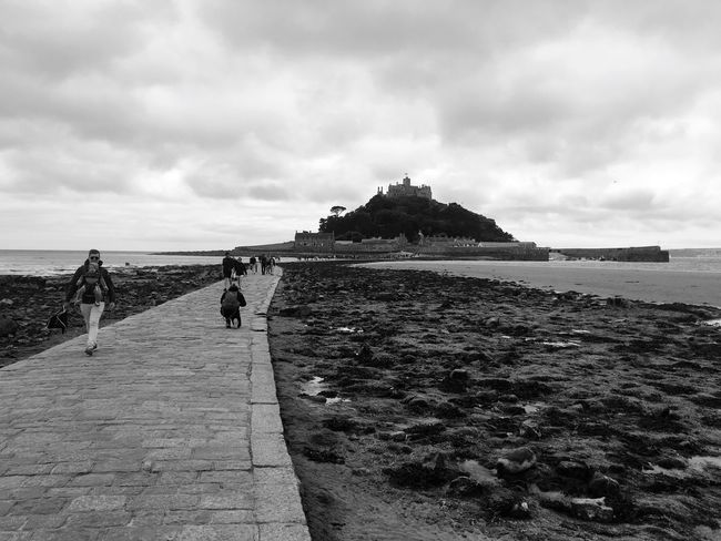 The Great Outdoors - 2017 EyeEm Awards Sea Beach Sky Water Shore Walking Nature Cloud - Sky Full Length Men Horizon Over Water Real People Day Leisure Activity Rock - Object Scenics Outdoors Beauty In Nature Lifestyles Sand Blackandwhite Cornwall Stmichaelsmount