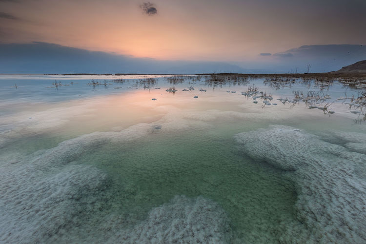 Scenic View Of Dead Sea Against Sky During Sunset
