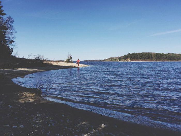 Calm lake against blue sky