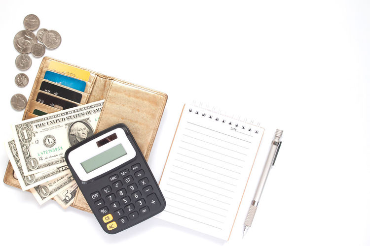 Calculator, currency paper, coins and credit card in purse on white background with blank notebook Budget Business Economics Economy Salary Bank Banking Banking And Finance Blank Business Calculator Copy Space Cost Currency Finance Finance And Economy Financial High Angle View Notebook Number Pen Still Life Studio Shot Table White Background