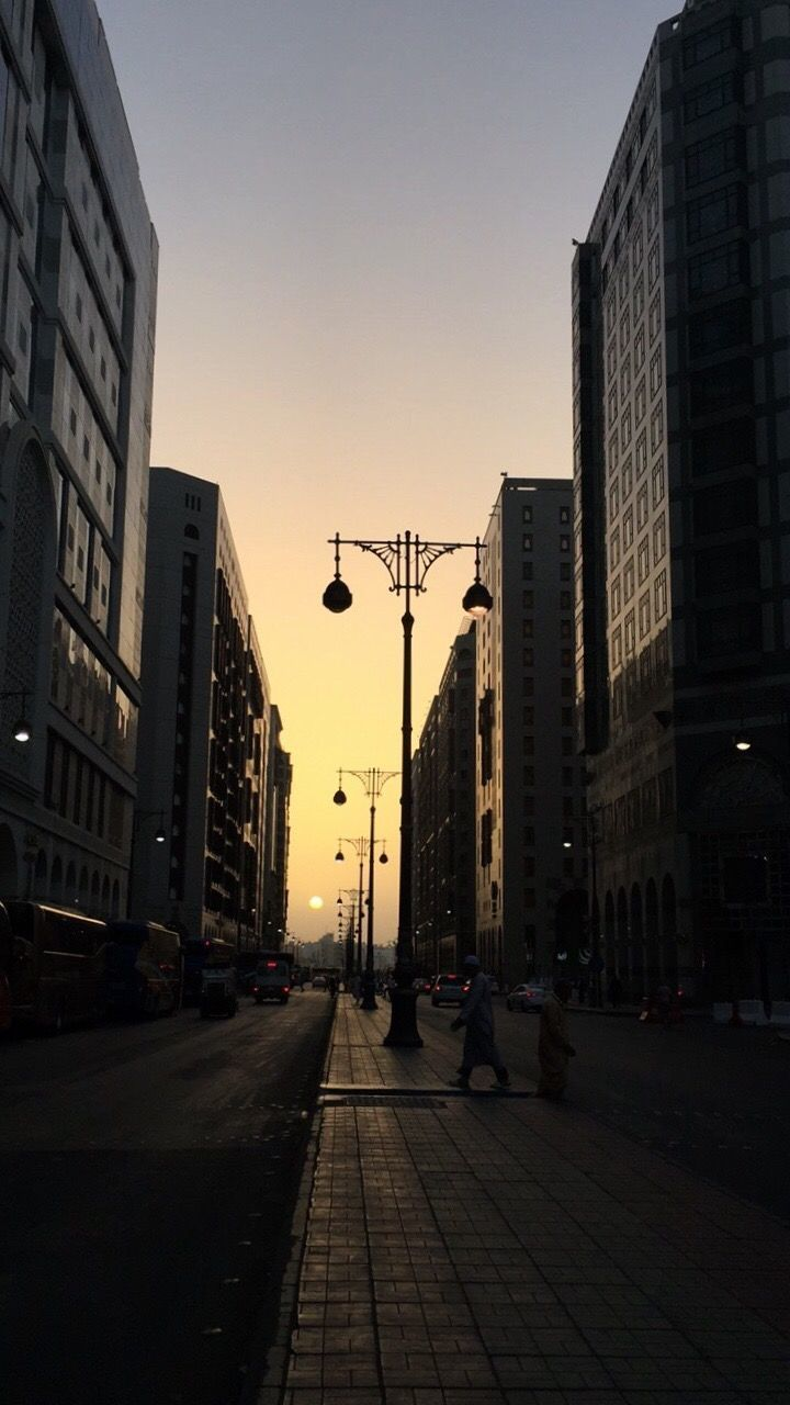 architecture, city, built structure, building exterior, street, sunset, street light, outdoors, skyscraper, sky, clear sky, day, no people