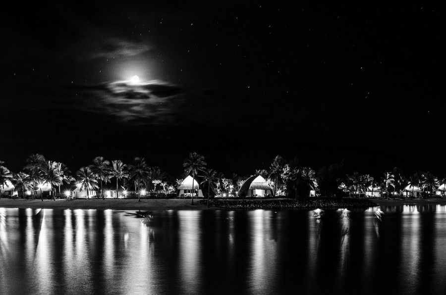 Bures under the monnlight Beauty In Nature Black And White Bure Fiji Illuminated Lagoon Moon Nature Night Night Photography No People Outdoors Palm Trees Reflection Scenics Sky Water Waterfront The Great Outdoors - 2017 EyeEm Awards