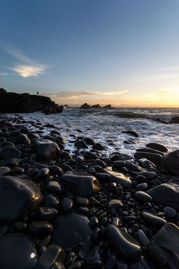 rock fishing Fishing Fisherman Wave Sea Low Tide Sunset Beach UnderSea Astronomy Water Lava Sky Seascape Coastline Ocean Surf