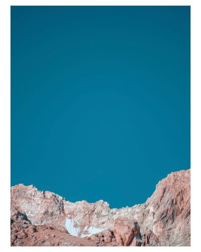 Low angle view of rock formation against blue sky