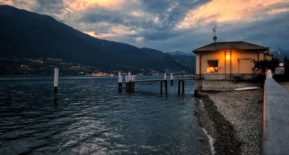 Mountain Cloud - Sky Outdoors Water Built Structure Architecture Building Exterior Sky Illuminated Nature Lake Como Italy Dervio Italy Awe Tranquility