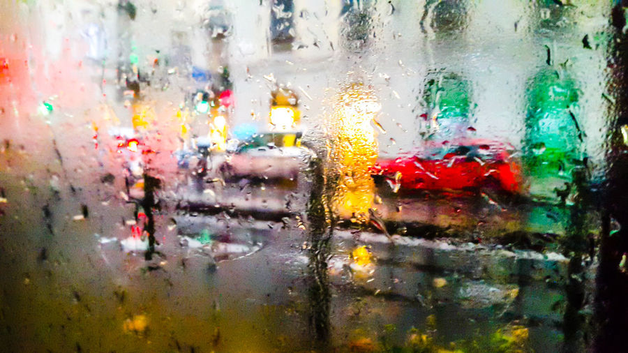 Heavy rain in the city Wet Glass - Material Water Drop Transparent Backgrounds Full Frame Window Close-up No People Multi Colored Indoors  Rain Glass Rainy Season Monsoon Nature RainDrop Textured Effect