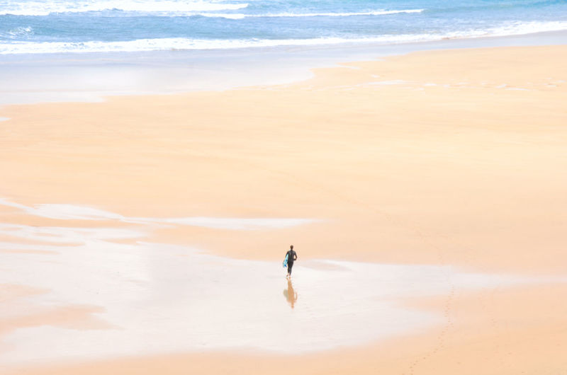 All alone. Asturias Asturias Paraiso Natural🌿🌼🌊🌞 Coastline Beach Beauty In Nature Day Desert Full Length Landscape Nature One Man Only One Person Outdoors Salt Flat Saltwater Sand Scenics Sea Sea And Sky Sky Surface Level Surfboard EyeEmNewHere Lost In The Landscape Second Acts