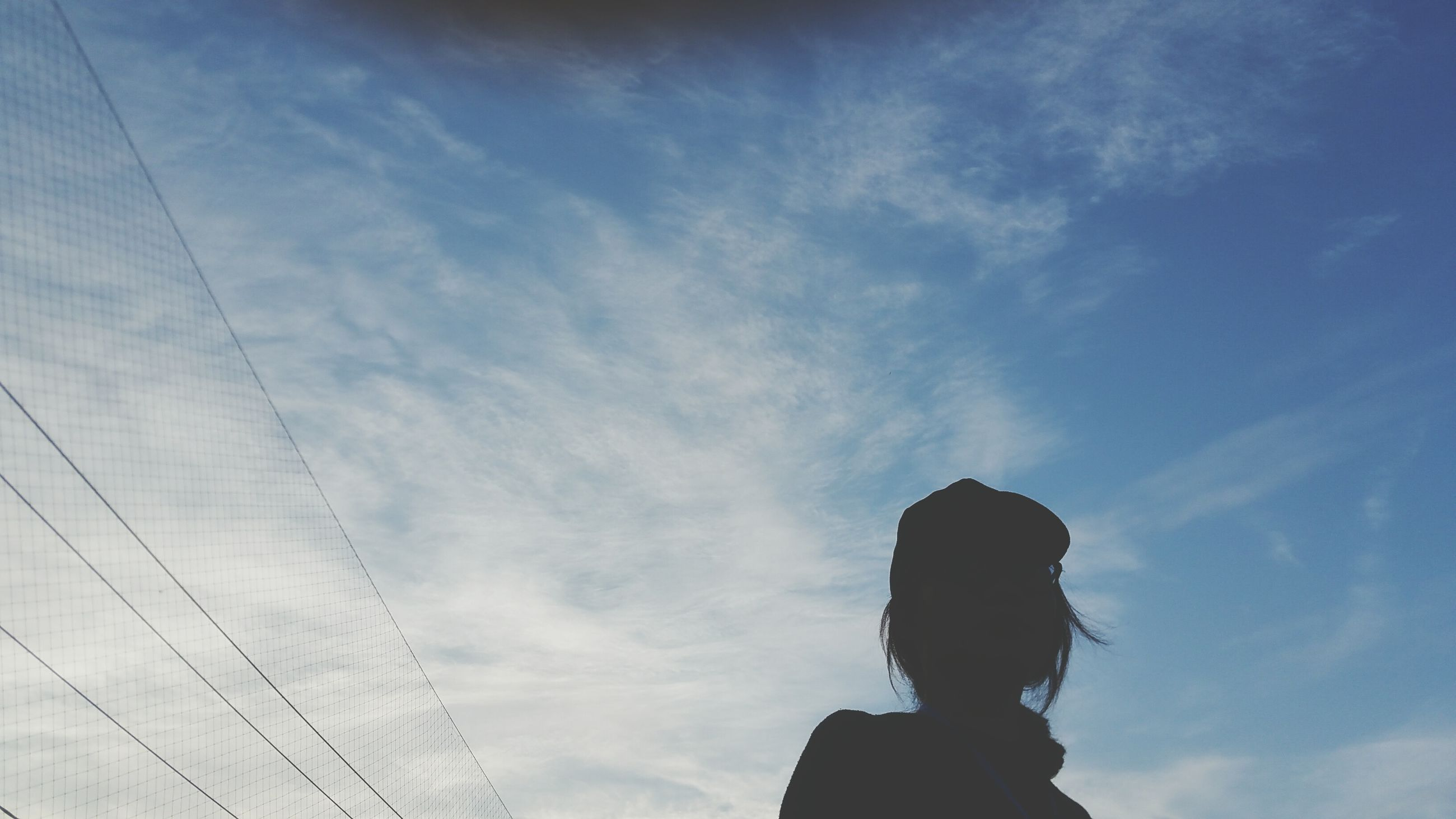 sky, cloud - sky, one person, low angle view, real people, day, people, outdoors, adults only, adult