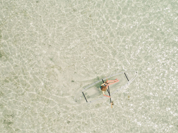 Directly above shot of woman on inflatable boat in sea