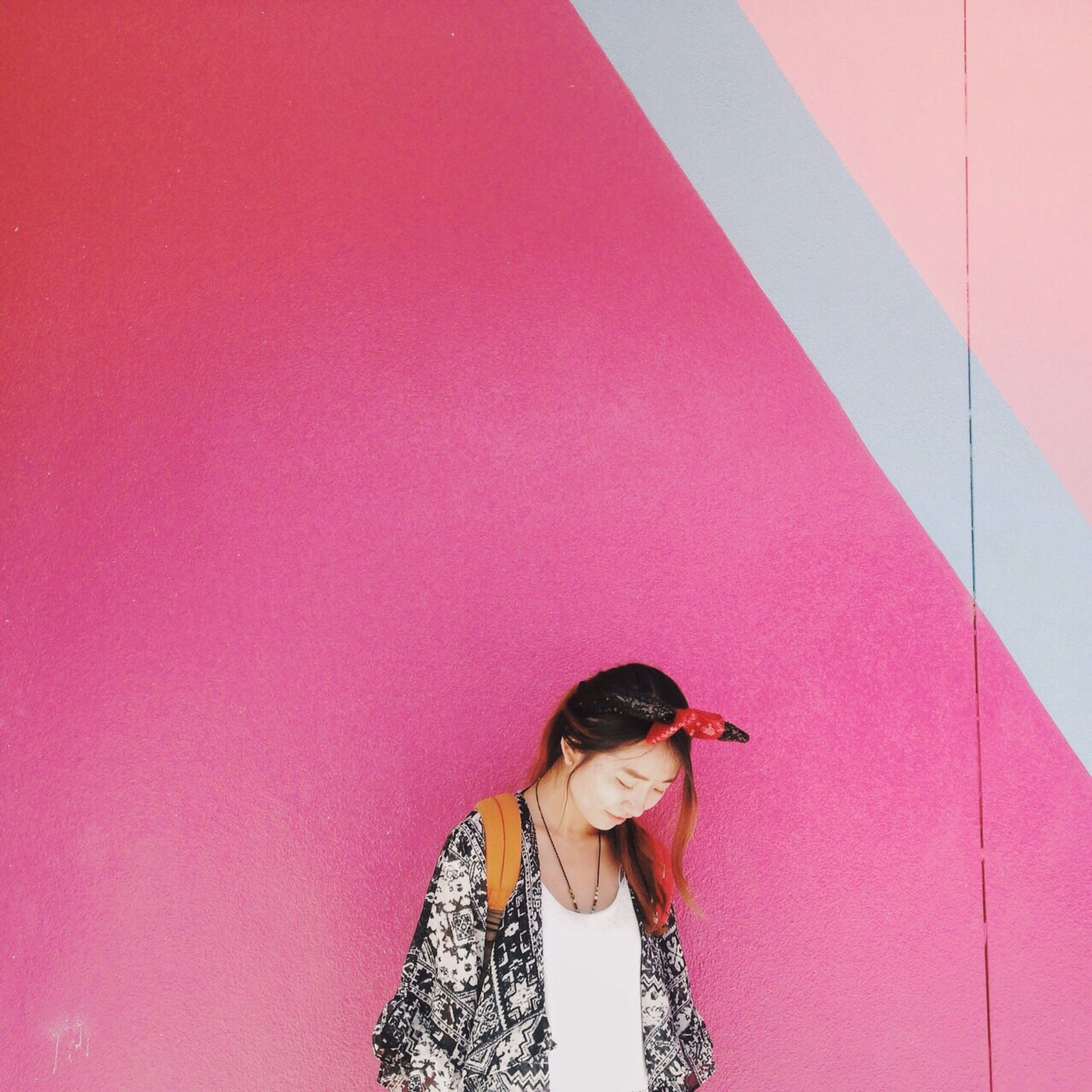 lifestyles, wall - building feature, leisure activity, young adult, casual clothing, person, copy space, standing, full length, front view, young women, looking at camera, portrait, red, wall, three quarter length, built structure, architecture