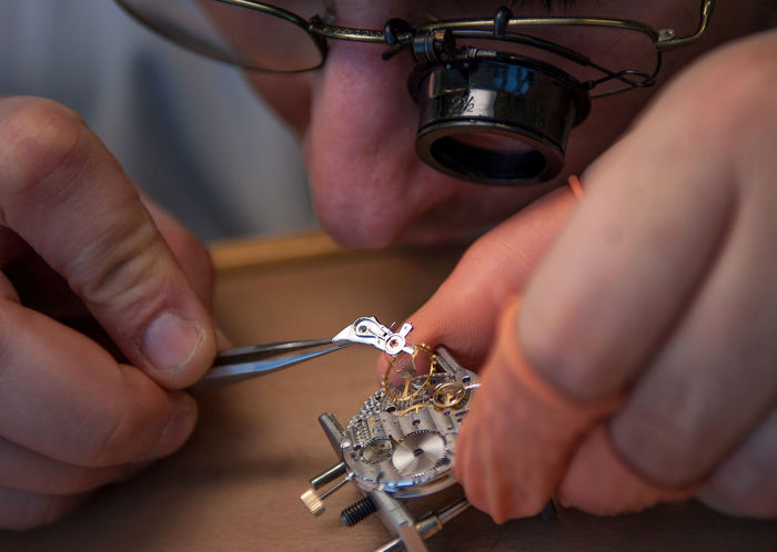 Switzerland, the watch, hour mile, watch Assembly, watch industry Close-up Equipment Holding Hour Mile Human Body Part Human Finger Human Hand Indoors  One Person People Real People Switzerland Technology The Watch Watch Assembly Watch Industry Working
