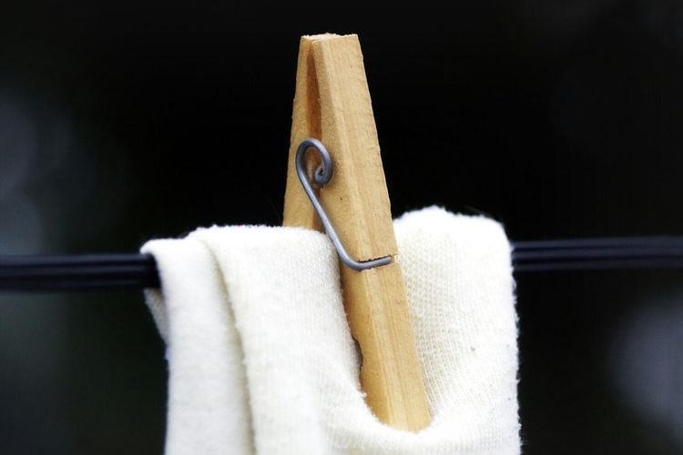 Close-up of clothes pin holding towel