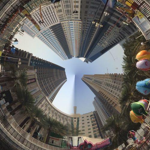 Little planet effect of buildings against clear sky