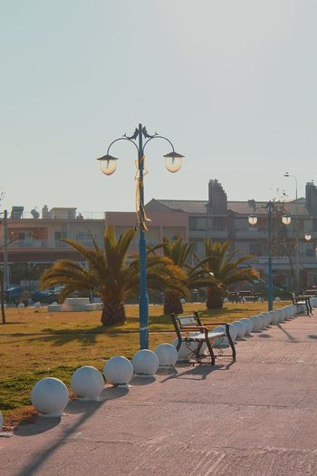 Bench Street Lamps Palms By The Seaside Greece Keramoti No People Outdoors City Sky Building Exterior Travel Destinations Horizontal Architecture Rollercoaster Day