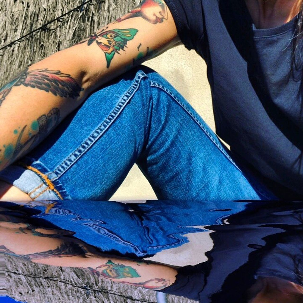 real people, one person, tattoo, casual clothing, lifestyles, day, outdoors, low section, human hand, men, human body part, close-up