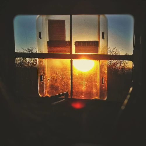 Close-up of window against sky during sunset