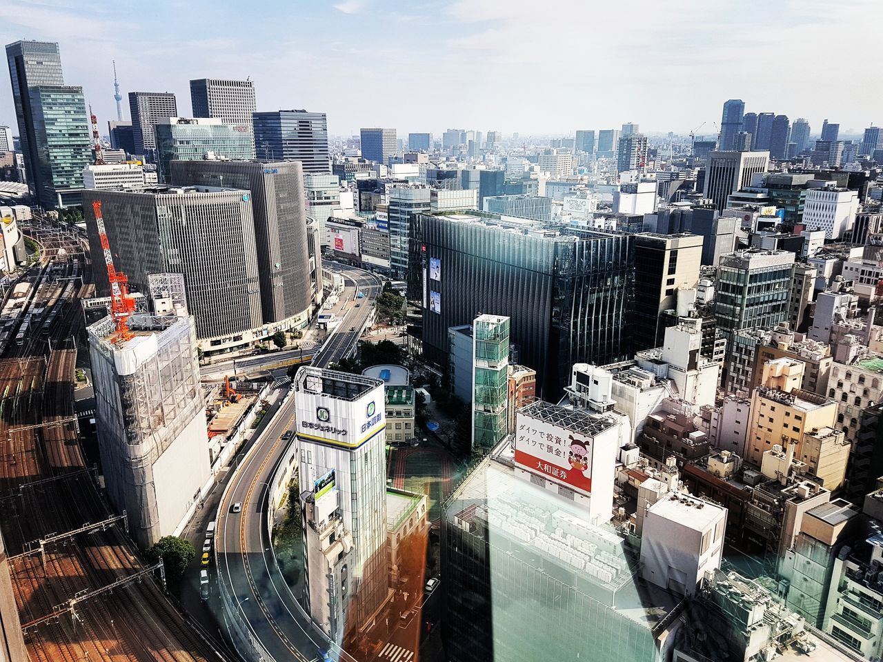 architecture, skyscraper, cityscape, city, building exterior, modern, built structure, high angle view, no people, outdoors, tall, day, sky