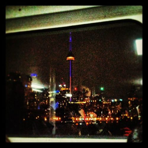 The CN Tower is purple and gold tonight Laurierday ? Missitalready