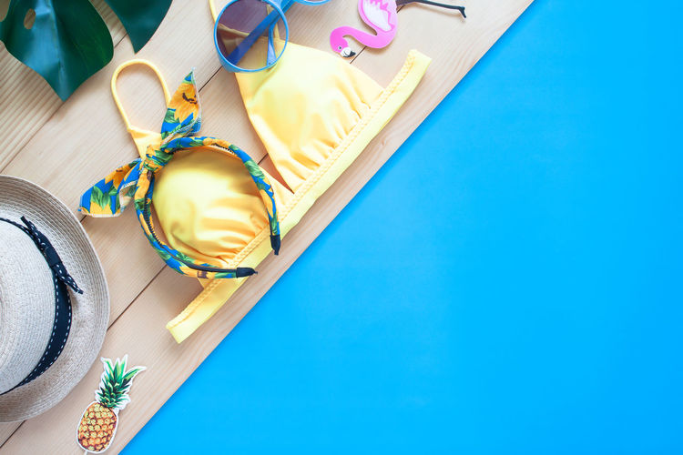 Flat lay fashion holiday summer Blue Indoors  High Angle View Table Copy Space No People Colored Background Close-up Art And Craft Publication Studio Shot Jewelry Lifestyles Business Blue Background Summer Summertime Vacation Vacation Time Holiday Beauty Beautiful Sea Workspace Fashion Weekend Activity Water Colorful Fresh Bikini Concept Design Detail Pattern Travel Traveling Tourism
