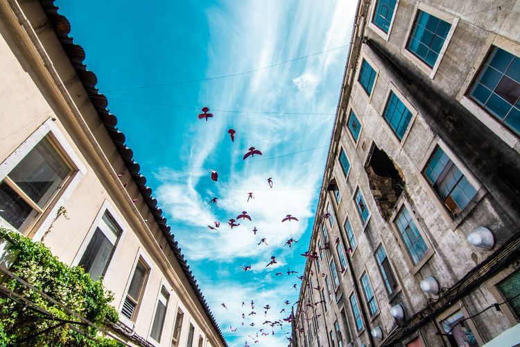Low angle view of buildings against sky in lisbon, portugal
