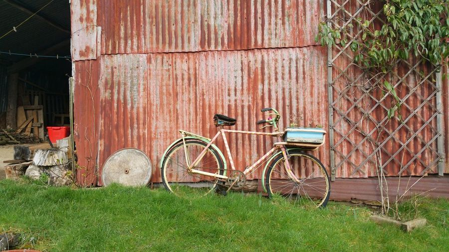 A nice rustic garden Bicycle Transportation Grass Architecture Built Structure Plant Mode Of Transportation Land Vehicle Day Building Exterior No People Stationary Nature Field Outdoors Building Fence House Land Green Color Wheel Garden Bike Barn Wales UK