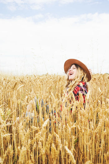 Agriculture Hat Field Crop  One Person Land Rural Scene Farm Cereal Plant Clothing Plant Landscape Real People Sky Growth Nature Young Adult Day Lifestyles Standing Outdoors Hairstyle Woman Countryside
