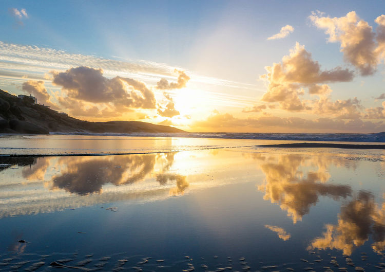 Beach Beauty In Nature Cloud - Sky Day Nature No People Outdoors Reflection Scenics Sea Sky Sunbeam Sunlight Sunset Tranquil Scene Water