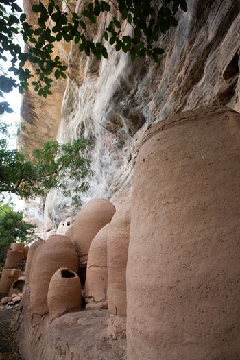 Ancient Civilization Animism Arid Climate Beauty In Nature Burkina Faso Day Geology Nature No People Outdoors Rock Rock - Object Rock Formation Tree