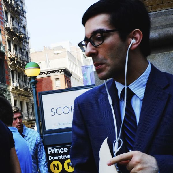 Suit Businessman Ear Buds Judgemental One Person Pointing Pulling A Face Real People Rude Street Photography