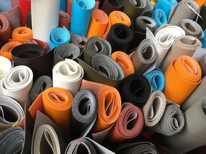 High Angle View Of Various Exercise Mats For Sale