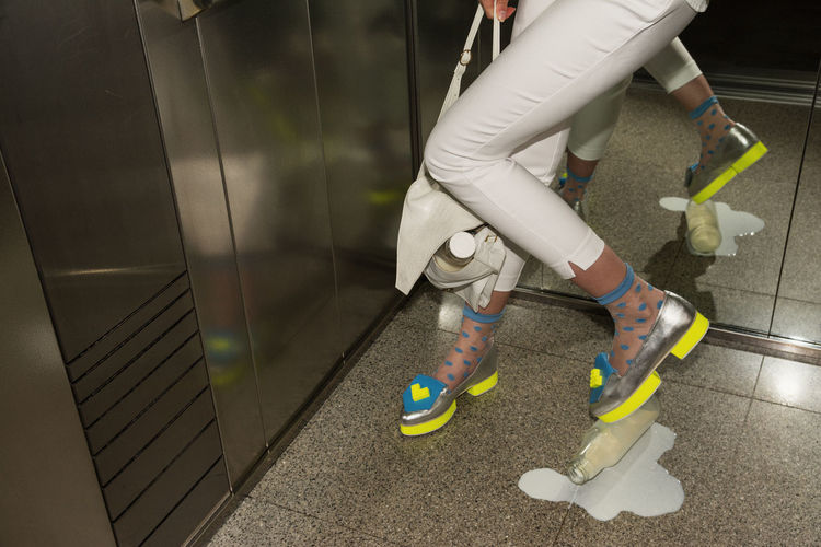 Please knock before entering. With love, your Love Elevator Elégance Fashion Legs Linas Was Here Monday Office Shoes Spilled Milk Urban White Woman Work The Fashion Photographer - 2018 EyeEm Awards #urbanana: The Urban Playground Humanity Meets Technology