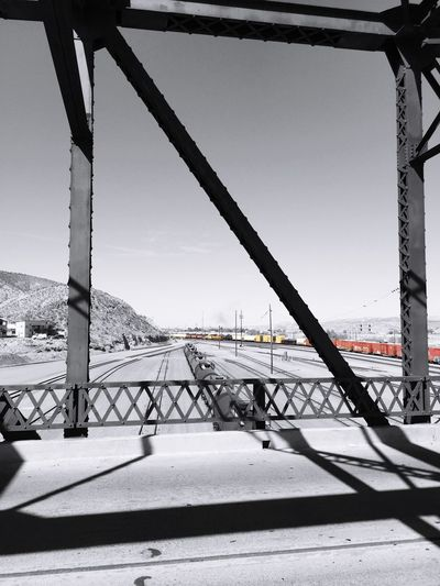 """""""Color Train"""" Busy rail yard at Harvey House station in Barstow, California from the First Street Bridge. Train Train Station Trainphotography Trainyard Bridge Bridge View Railway Railroad Railroad Tracks Selective Color"""