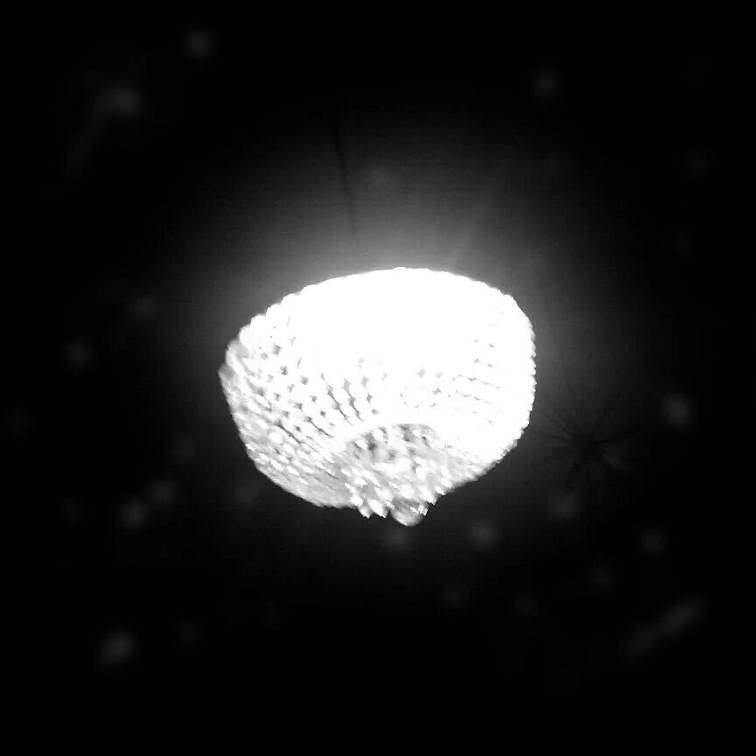 illuminated, night, close-up, lighting equipment, electricity, dark, circle, low angle view, focus on foreground, hanging, no people, indoors, sphere, glowing, ceiling, nature, pattern, electric light, shape, light - natural phenomenon