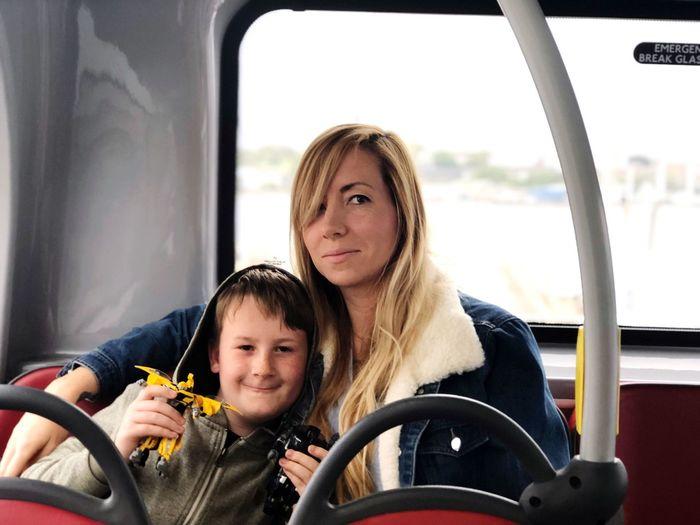 Portrait of happy woman sitting in bus